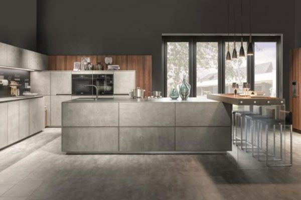 Warendorf Küche Concrete | Betonfront in Kombination mit Nussbaum | Miele Center Höpperger Innsbruck